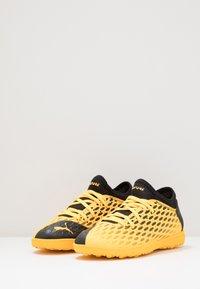 Puma - FUTURE 5.4 TT JR UNISEX - Astro turf trainers - ultra yellow/black - 3