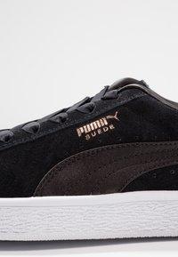 Puma - Loaferit/pistokkaat - black - 2
