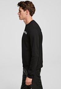 KARL LAGERFELD - GRAFFITI - Sweatshirt - black - 2