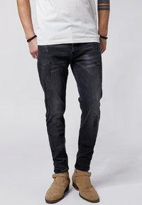 Tigha - Slim fit jeans - vintage black - 0