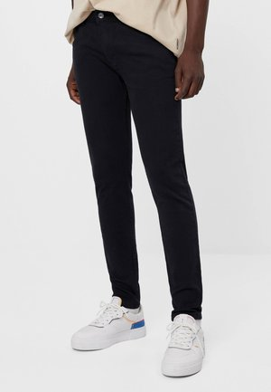 SUPER - Slim fit jeans - black
