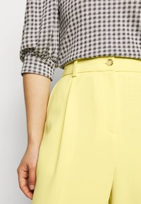 Topshop Petite - CLEAN STRAIGHT TROUSERS - Trousers - yellow - 6