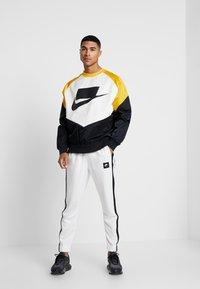 Nike Sportswear - AIR PANT - Træningsbukser - summit white/summit white/black - 1