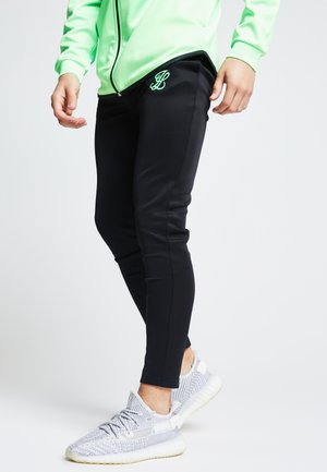 LONDON  - Tracksuit bottoms - black  neon gree