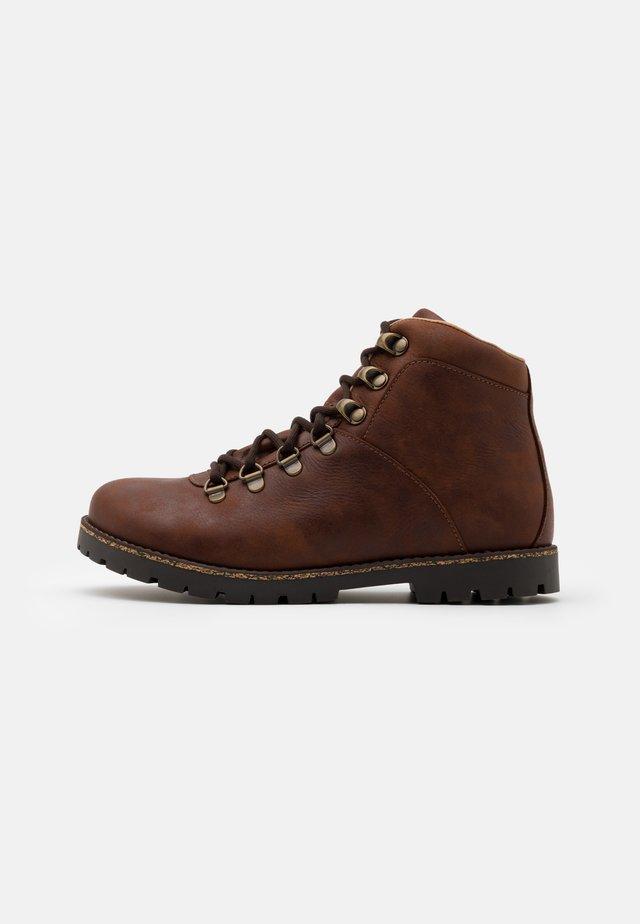 JACKSON UNISEX - Ankle boots - dark brown