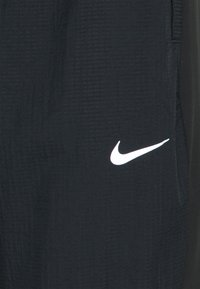 Nike Performance - ESSENTIAL THERMA PANT - Tracksuit bottoms - black - 2