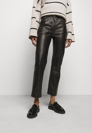 NAOKO - Leather trousers - black