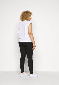 Fila Plus - EDWINA - Leggings - Trousers - black - 2