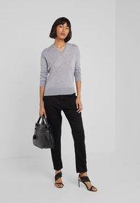 AG Jeans - CADEN - Trousers - super black - 1