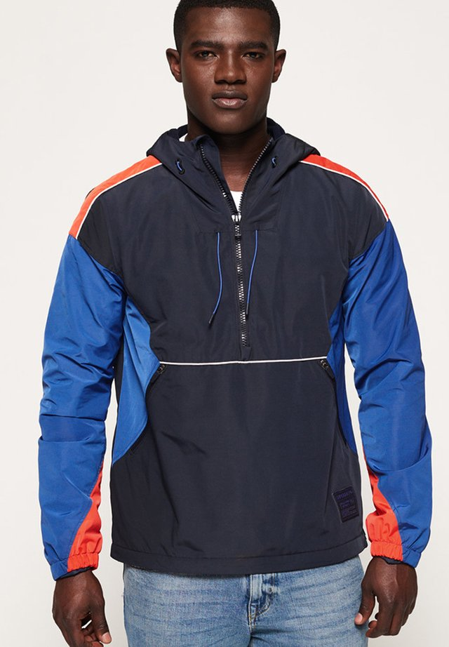 JARED OVERHEAD CAGOULE - Training jacket - blue