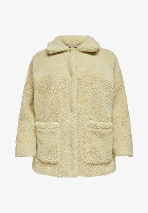 Halflange jas - beige