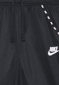 Nike Sportswear - POLY - Tracksuit bottoms - black/white - 2