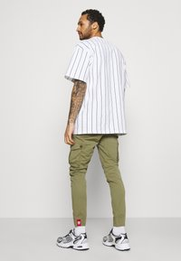 Alpha Industries - JOGGER - Cargo trousers - olive - 2