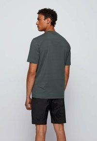 BOSS - TCHUP - Print T-shirt - dark green - 2
