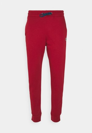 SLIM FIT JOGGER - Tracksuit bottoms - red