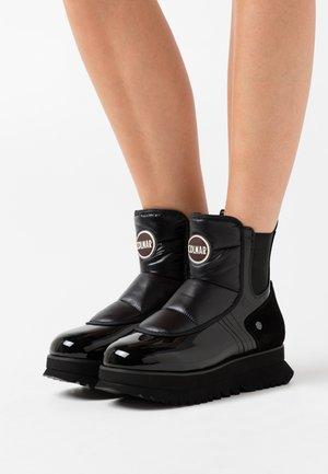 CLAUDIE - Platform ankle boots - black