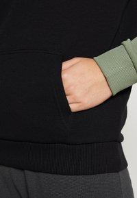 Fila Tall - LORI HOODY - Jersey con capucha - sea spray/black/bright white - 6