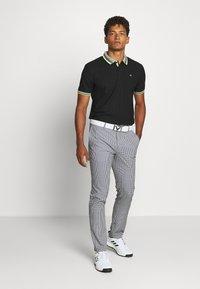 Calvin Klein Golf - SPARK - T-shirt de sport - black - 1
