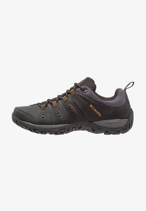 WOODBURN II - Hiking shoes - black/goldenrod