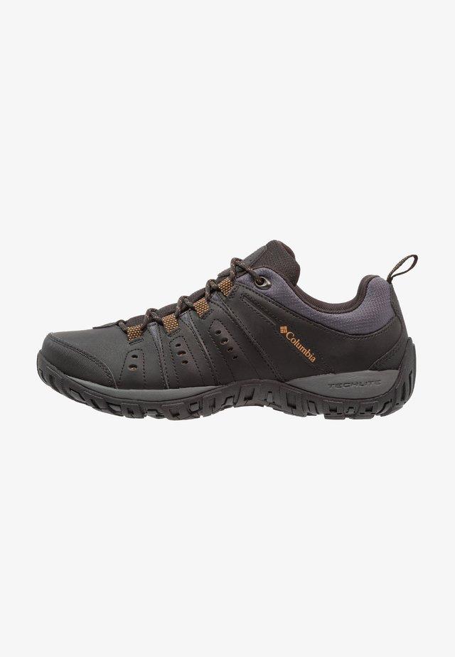 WOODBURN II - Hiking shoes - black/goldenrod