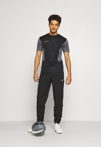 Nike Performance - PANT - Tracksuit bottoms - black/white