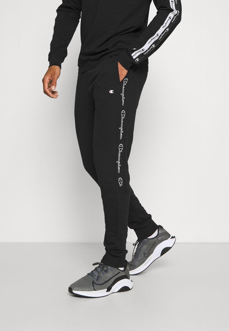 Champion - CUFF PANTS - Pantaloni sportivi - black