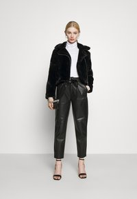 Vero Moda - VMTHEA BIKER JACKET - Winter jacket - black - 1
