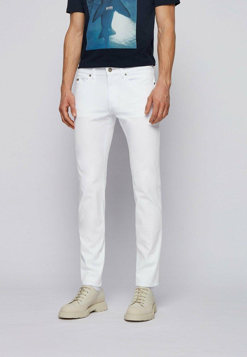 BOSS - DELAWARE - Slim fit jeans - white