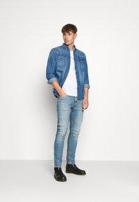 Tiger of Sweden Jeans - PISTOLERO - Jeans straight leg - light blue - 1