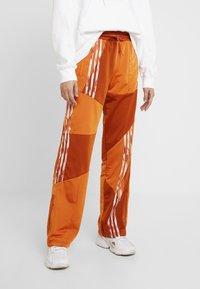 adidas Originals - DANIELLE CATHARI JOGGERS - Trousers - fox red - 0