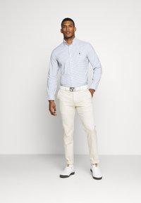 Polo Ralph Lauren Golf - GOLF PANT ATHLETIC - Trousers - basic sand - 1
