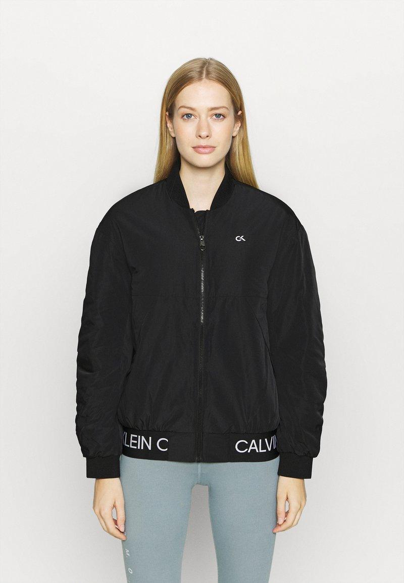 Calvin Klein Performance - PADDED JACKET - Training jacket - black