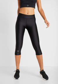 Under Armour - HEATGEAR CAPRI - Pantalón 3/4 de deporte - black - 0