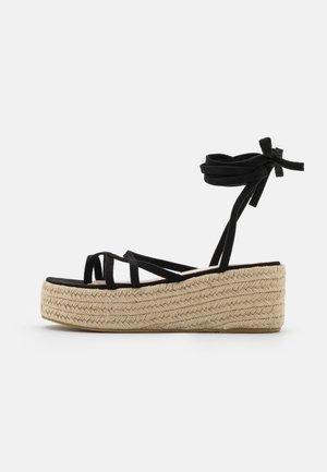 LINDSEY - T-bar sandals - black