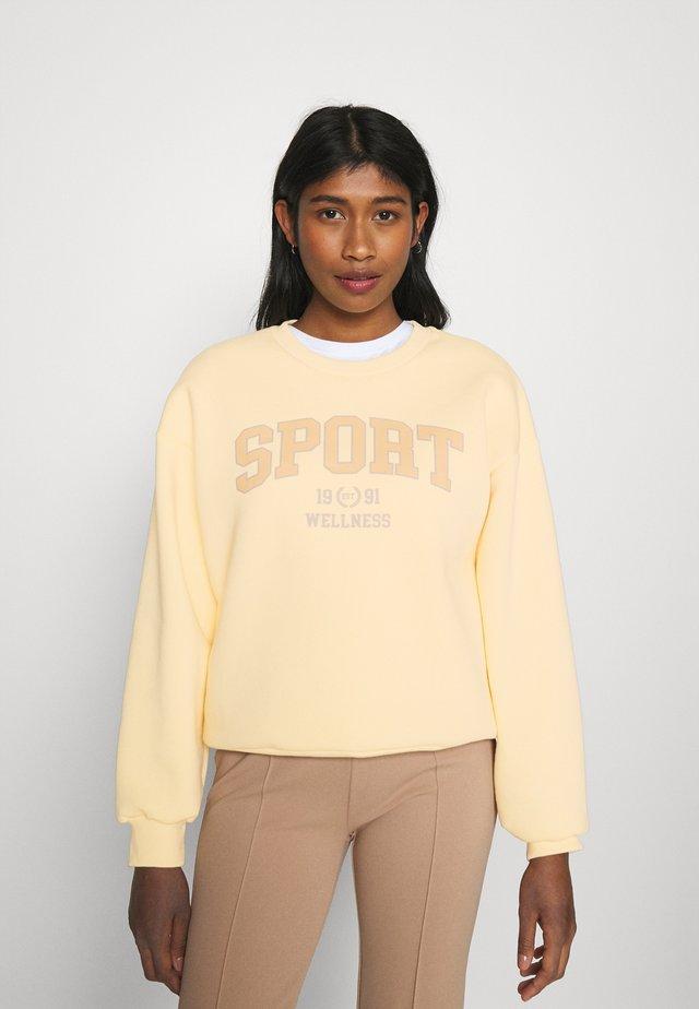 RILEY  - Sweatshirt - golden