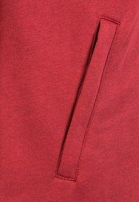 Puma - CUP CASUALS KAPUZENJACKE - Sports jacket - pomegranate / puma white - 2
