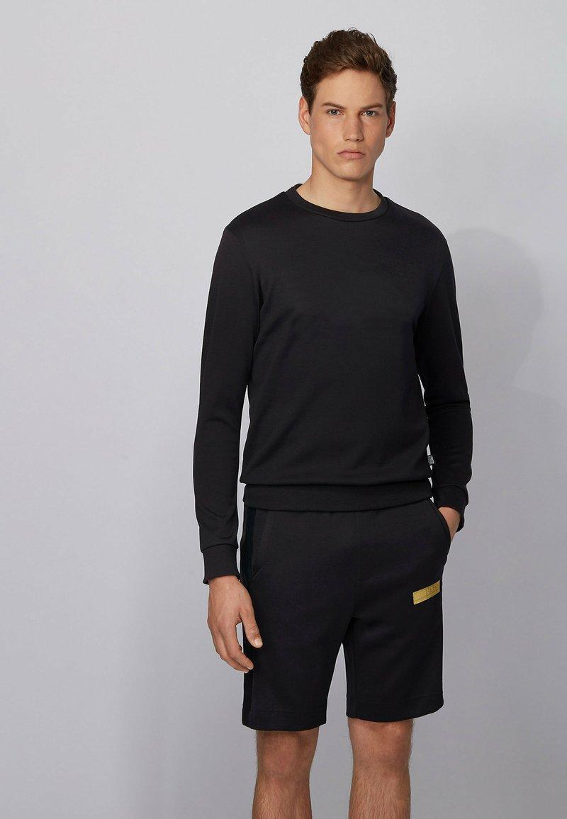 BOSS - HEADLO BATCH Z - Pantalon de survêtement - black