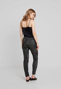 Dranella - DREBEA PANT TESSA FIT - Trousers - black - 2