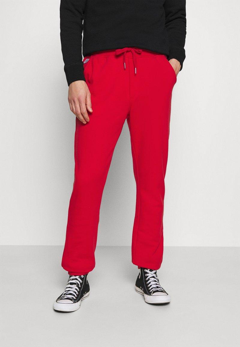 Schott - PHIL - Tracksuit bottoms - red
