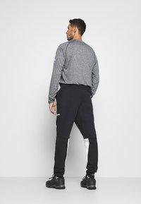 adidas Performance - SPORTSWEAR PRIMEGREEN PANTS - Träningsbyxor - black/white - 2