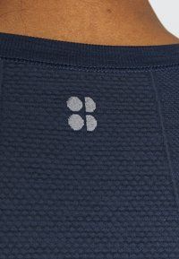 Sweaty Betty - ATHLETE SEAMLESS WORKOUT - Long sleeved top - navy blue - 4