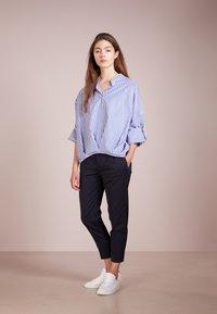 DRYKORN - EMOM - Trousers - blue denim - 1
