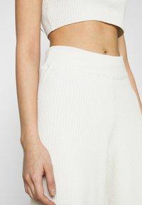 NA-KD - NA-KD X ZALANDO EXCLUSIVE SOFT RIBBED PANTS - Kalhoty - offwhite - 3