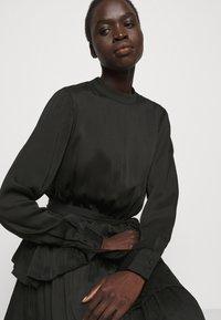 Bruuns Bazaar - EMILLEH ENOLA DRESS - Cocktail dress / Party dress - black - 3