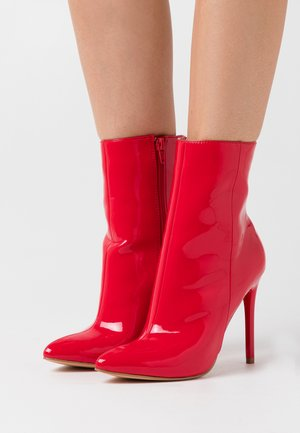 High heeled ankle boots - red