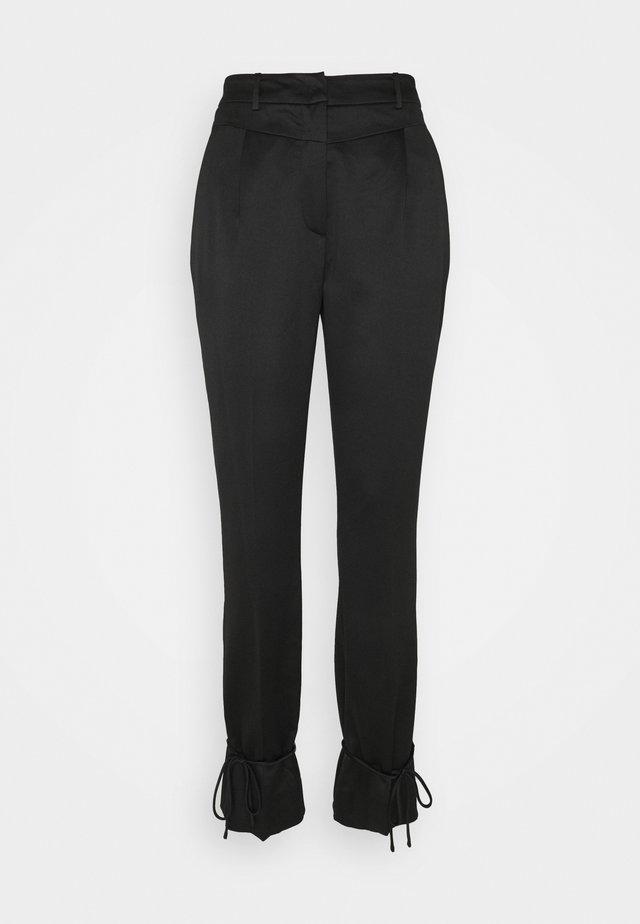 HORTENSIA JOKI PANT - Trousers - black