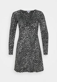 SPOT FULL SLEEVE PLUNGE MINI DRESS - Day dress - black/white