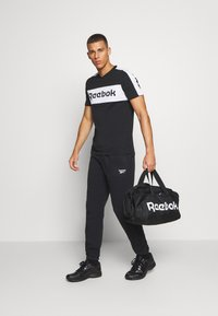 Reebok - ACT CORE GRIP - Sports bag - black - 0