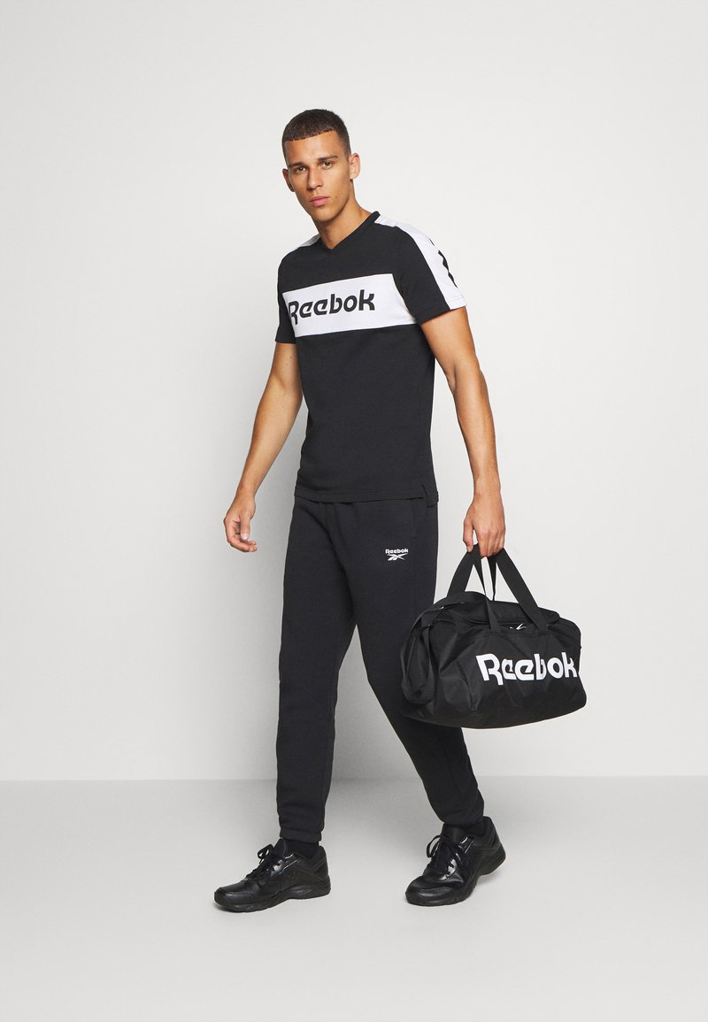 Reebok - ACT CORE GRIP - Sports bag - black