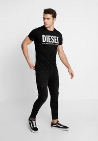 Diesel - T-DIEGO-LOGO T-SHIRT - Print T-shirt - black - 1